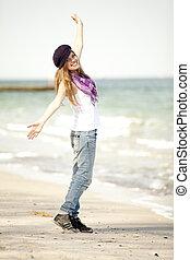 Funny teen girl at the beach.