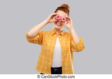 funny teenage girl with donuts instead of eyes