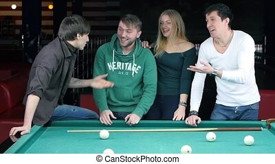 Funny time with friends in billiard club. Slow motion