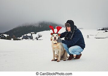 Funny walk with dog in the snowy landscape