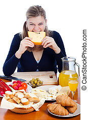Funny woman eating cheese
