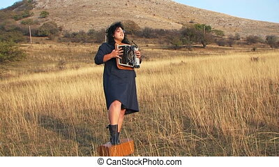 Funny Woman In Black Playing Typewriter And Singing At Nature