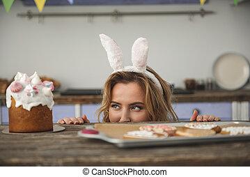 Funny woman in bunny ears headband