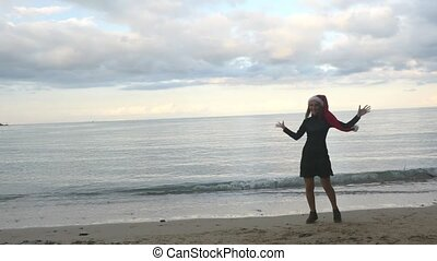 Funny woman in Santa hat jumping near the sea - Christmas ...