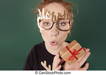 Funny woman showing a christmas present