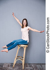 Funny woman sitting on the chair