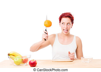funny woman trying to cut a orange