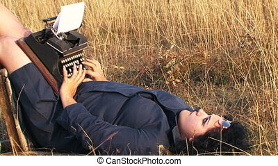 Funny Woman Typing On Vintage Typewriter Lying On Chair At Nature