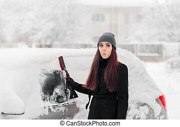 Funny Woman with a Brush Removing Snow from Car
