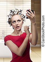 funny woman with hair rollers