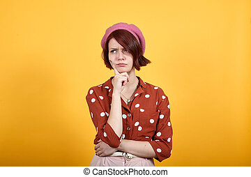 Funny woman with hand on chin thinking about question. Doubt concept.