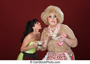 Funny Women With Teacups - Woman with cup of tea tries to...