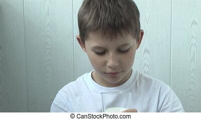 Funny yogurt left a footprint on the boy's lips