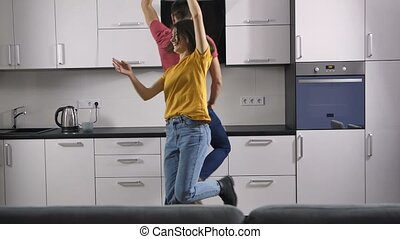 Funny young couple dancing at home - Sweet and funny young...
