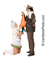 Funny young couple with carrot