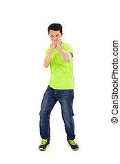 funny young man make a hand gun gesture