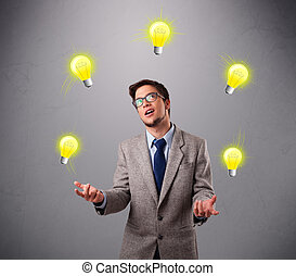 young man standing and juggling with light bulbs