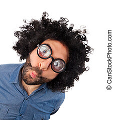Funny young man with unkempt hair and thick glasses.