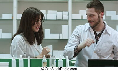 Funny young pharmacist dressed in white uniform dancing at pharmacy