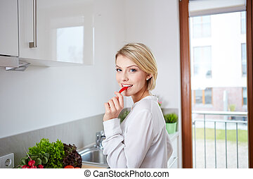woman showing slices of bell pepper
