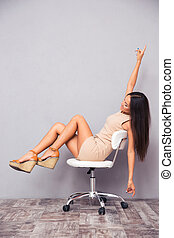 Funny young woman sitting on chair