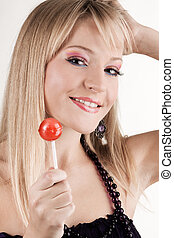 Funny young woman with a lollipop