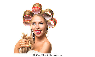Funny young woman with hair curlers on her head isolated on white.