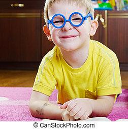 Funy boy in glasses