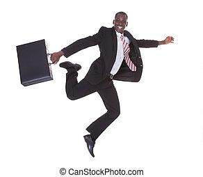 funzionamento uomo affari, cartella, presa a terra, africano