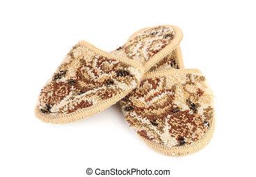Fur house slippers crossed.