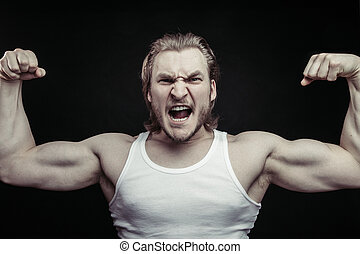 furious bodibuilder posing to the camera