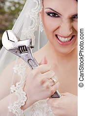 Furious bride holding wrench
