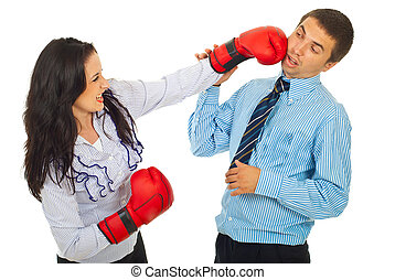Furious business woman kicking man