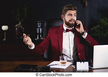 Furious businessman getting a telephone call