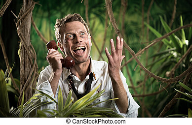Furious businessman on the phone lost in the jungle - Angry...