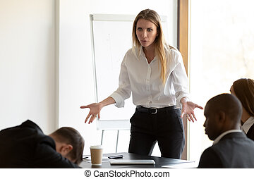Furious businesswoman confused by employee dozing at briefing