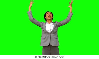 Furious businesswoman raising arms on green screen in slow...