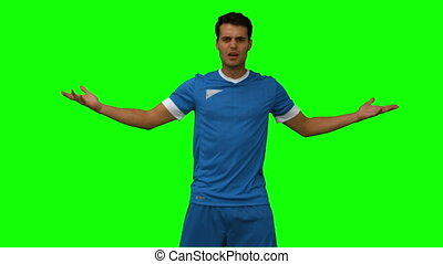 Furious football player gesturing on green screen in slow...
