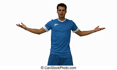 Furious football player gesturing on white screen in slow...