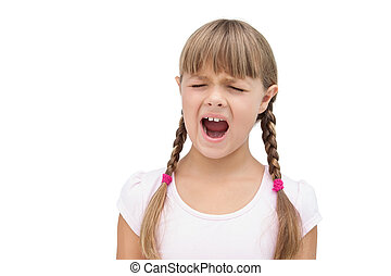 Furious little girl with eyes closed on white background