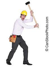 Furious man holding a mallet