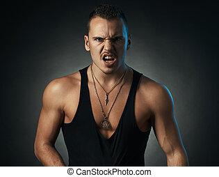 furious man on black background