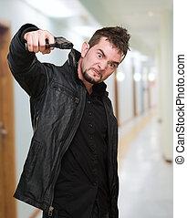 furious man pointing with a gun