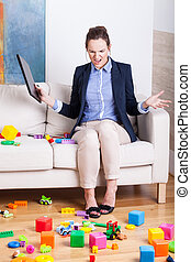 Furious woman in a room full of kids toys