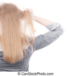Furious woman pull hair out of head.