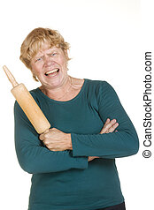 Very furious woman with wooden roller pin