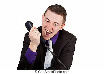 Furious - Young businessman screaming into a phone -...
