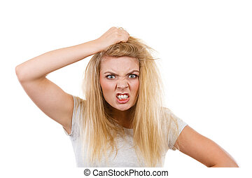 Furiously mad angry blonde woman holding hair