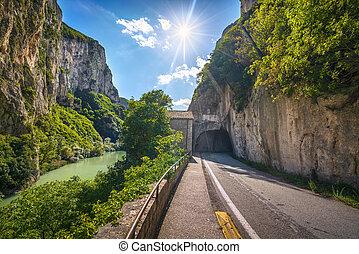 Furlo Pass or Gola del Furlo, road, river and gallery on the ancient Roman road Via Flaminia. Marche Italy.