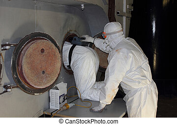 Furnace boiler clean - An engineer wearing ppe for a boiler ...